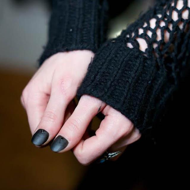 Black-matte-thumb-nails-with-tiny-moons-at-Assembly