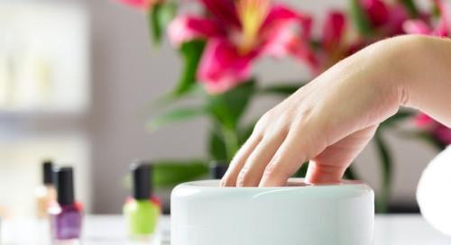 bigstock-Woman-in-a-nail-salon-receivin